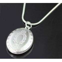 Atsidarantis ovalus sidabruotas medalionas